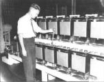 Inspecting the batteries at the Peninsula Telephone Company