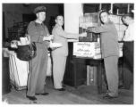 Florida Citrus Mutual staff serves orange juice in the Lakeland, Florida Post Office