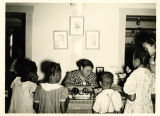 Librarian Elsie Dunbar works with children at the Virginia Avenue Branch of the Lakeland Public Library