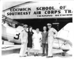 Staff and visitors in front of a hangar at the Lodwick School of Aeronautics